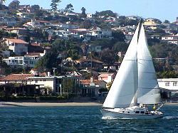 View of San Diego Bay  sailboat with Point Loma in background
